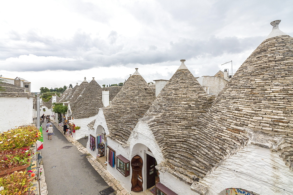 The typical huts called Trulli built with dry stone with a conical roof Alberobello province of Bari Apulia Italy Europe