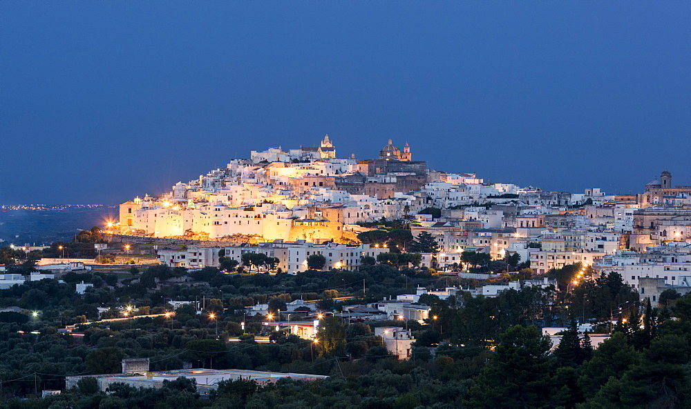 View of typical architecture and white houses of the old medieval town at dusk Ostuni province of Brindisi Apulia Italy Europe