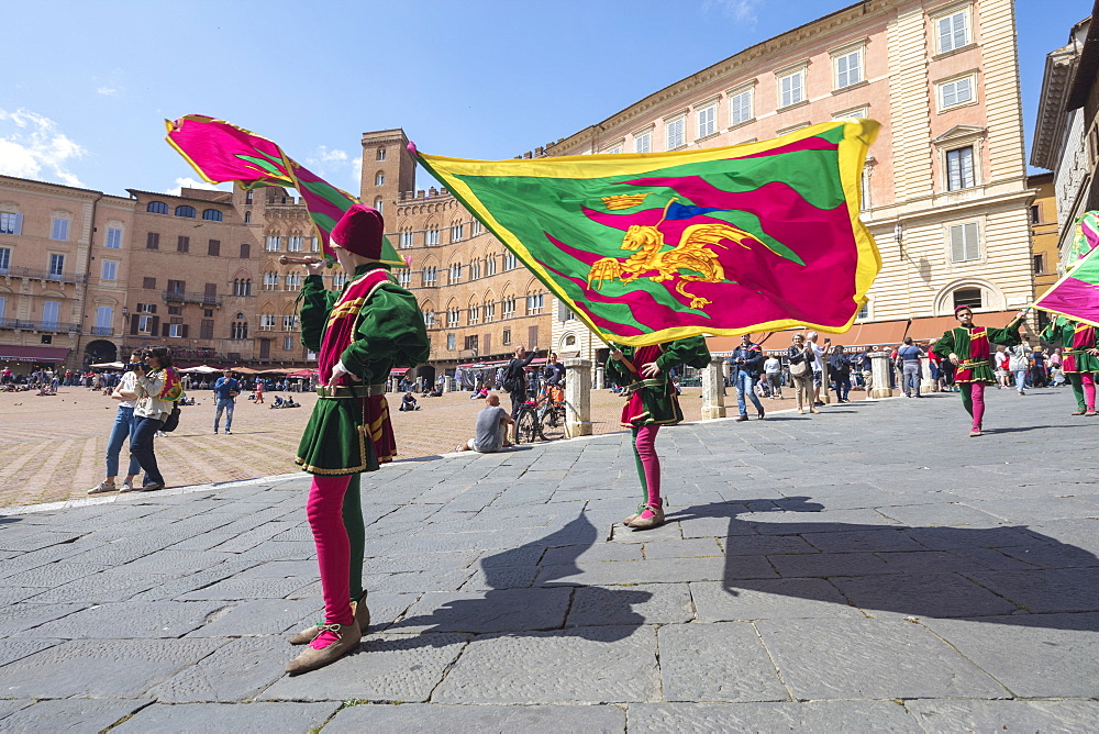 Typical exhibition of traditional clothes and flags of the different contradas Piazza del Campo Siena Tuscany Italy Europe - 1179-1936