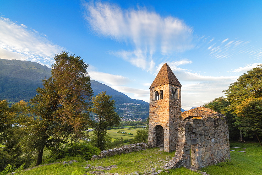 Sunset sky frames the ancient Abbey of San Pietro in Vallate Piagno Sondrio province Lower Valtellina Lombardy Italy Europe