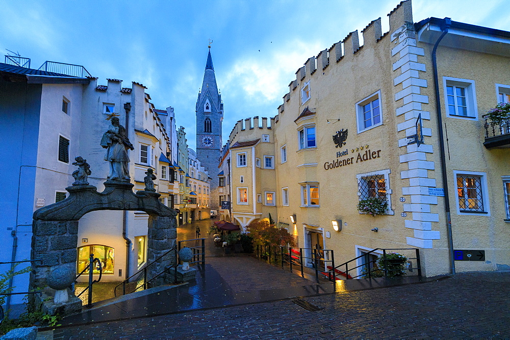The Goldener Adler Hotel and the bell tower of Cathedral of Brixen (Bressanone), province of Bolzano, South Tyrol, Italy, Europe