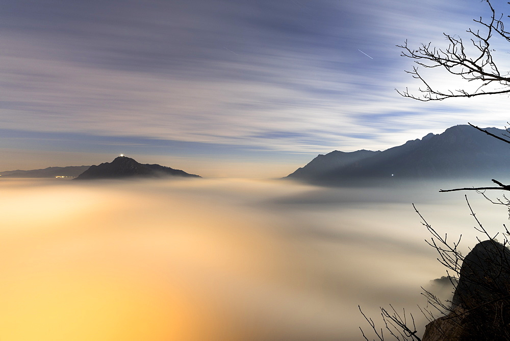 Fog and clouds at dawn seen from Monte San Martino, Province of Lecco, Lombardy, Italy, Europe