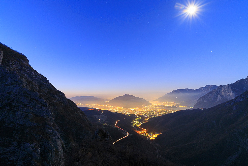 Dusk on the illuminated city of Lecco seen from the road to Morterone Lombardy Italy Europe - 1179-2364