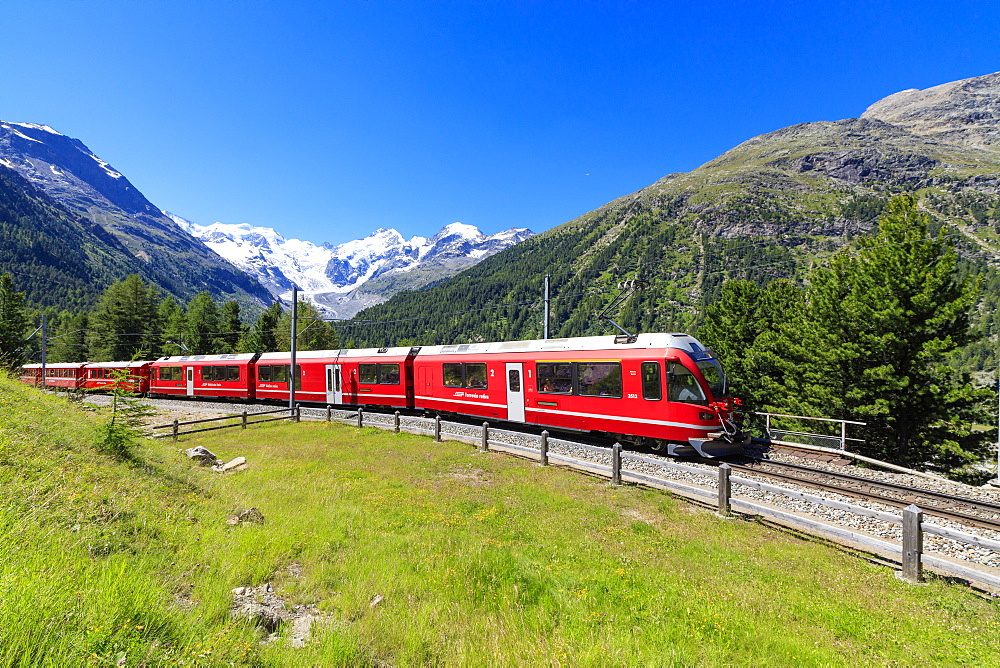 The Bernina Express train at Morteratsch in summer, Engadine, Canton of Graubunden, Switzerland, Europe