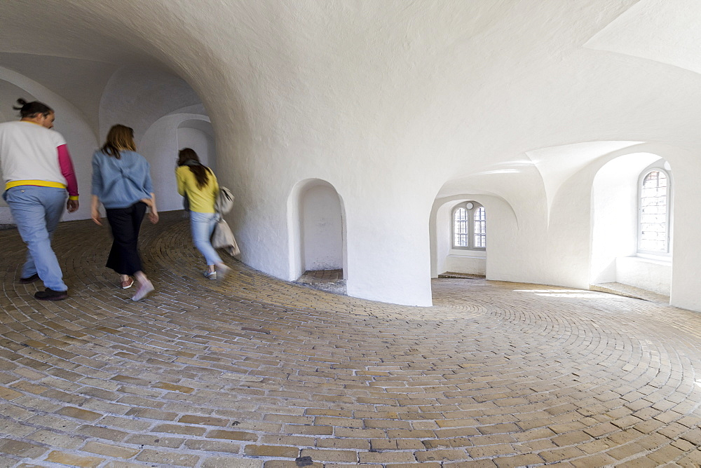 People in the spiral ramp inside the Round Tower (Rundetaarn), Copenhagen, Denmark