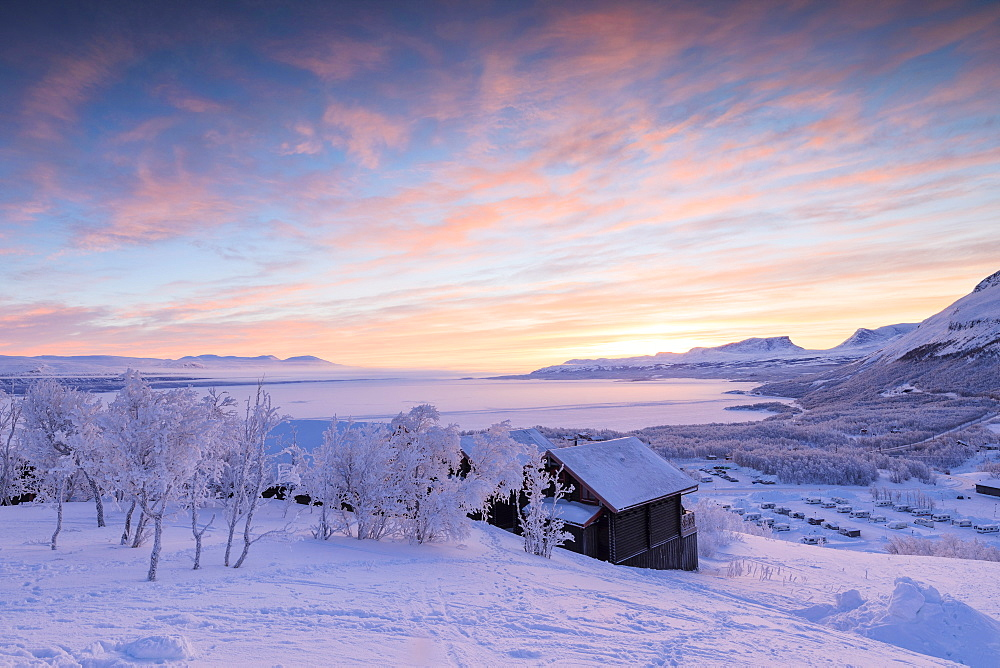 Pink sunrise on the snowy landscape, Bjorkliden, Abisko, Kiruna Municipality, Norrbotten County, Lapland, Sweden, Scandinavia, Europe