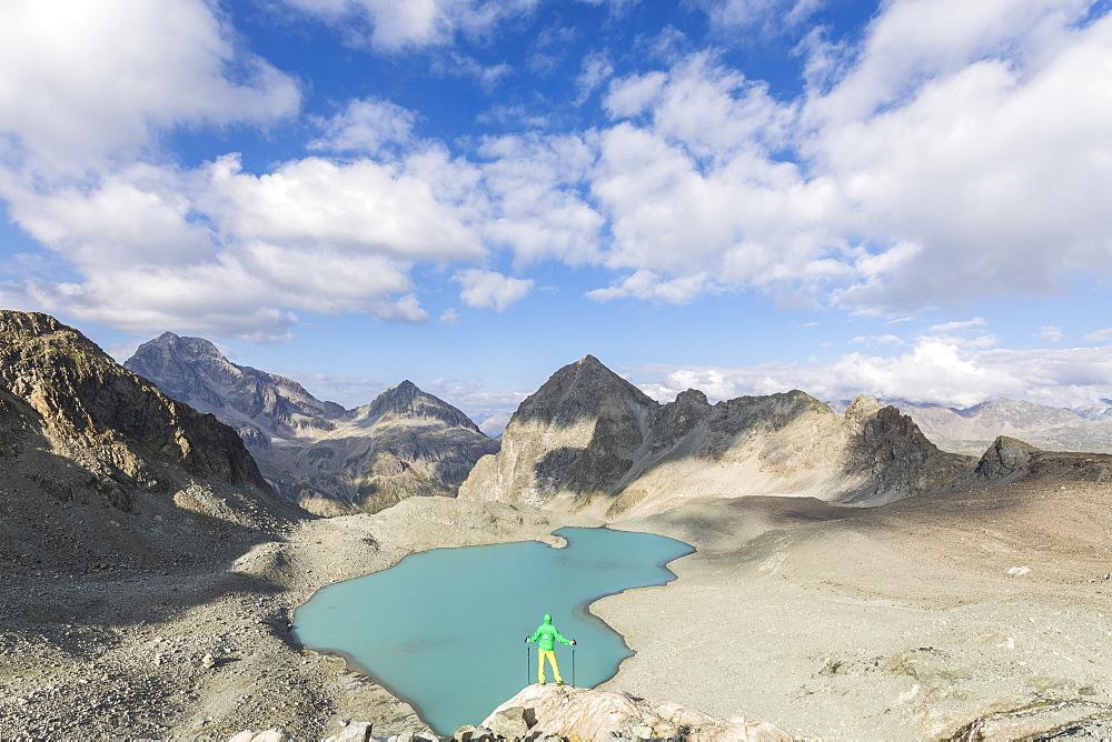 Hiker on the rocks overhanging Lej Lagrev, Silvaplana, canton of Graubünden, Engadine, Switzerland - 1179-2557