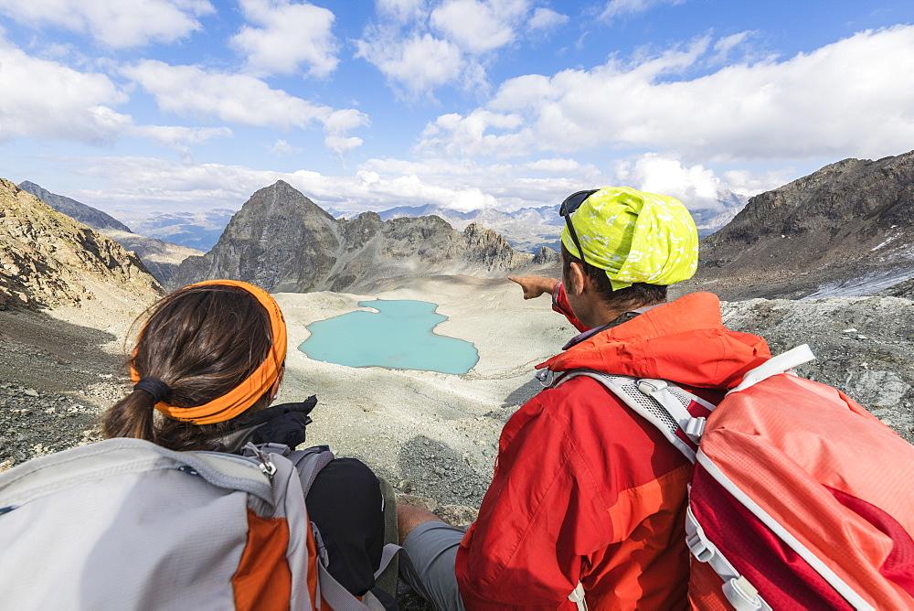 Hikers at Lej Lagrev during summer, Silvaplana, canton of Graubünden, Engadine, Switzerland - 1179-2558