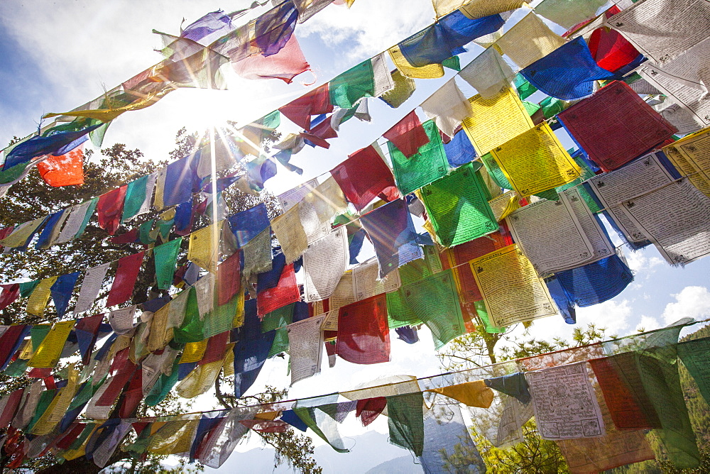 The Tibetan prayer flags made of colored cloth that are often hung on the top of the mountains to bless places, Bhutan, Asia