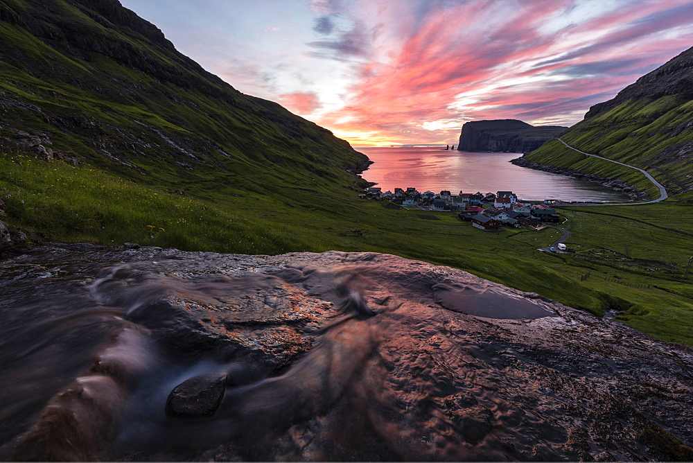Water of creek flows on rocks, Tjornuvik, Sunda Municipality, Streymoy Island, Faroe Islands