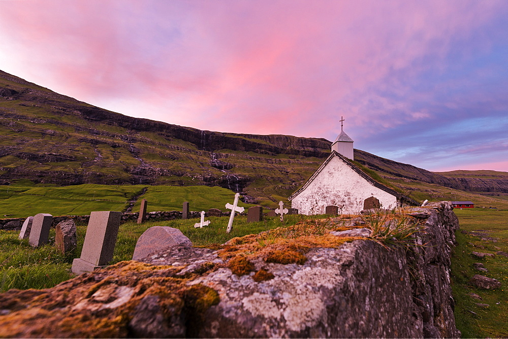 Pink sunset on church and cemetery, Saksun, Streymoy Island, Faroe Islands, Denmark, Europe