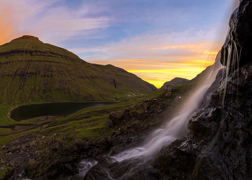 Panoramic of waterfall at sunset, Saksun, Streymoy Island, Faroe Islands