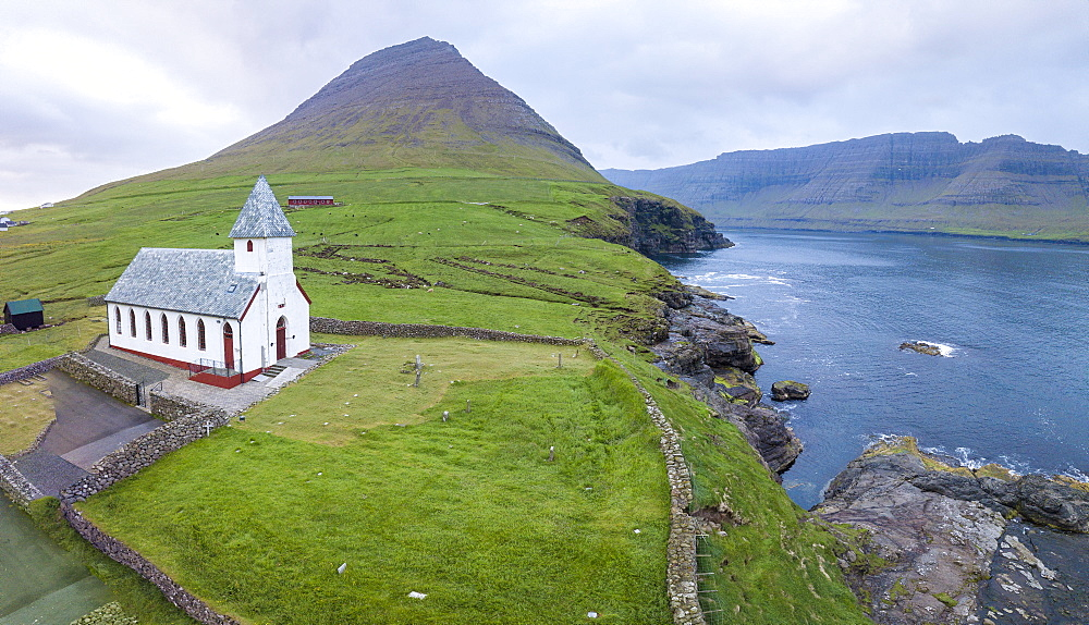 Panoramic of Church of Vidareidi by the sea, Vidoy island, Faroe Islands, Denmark