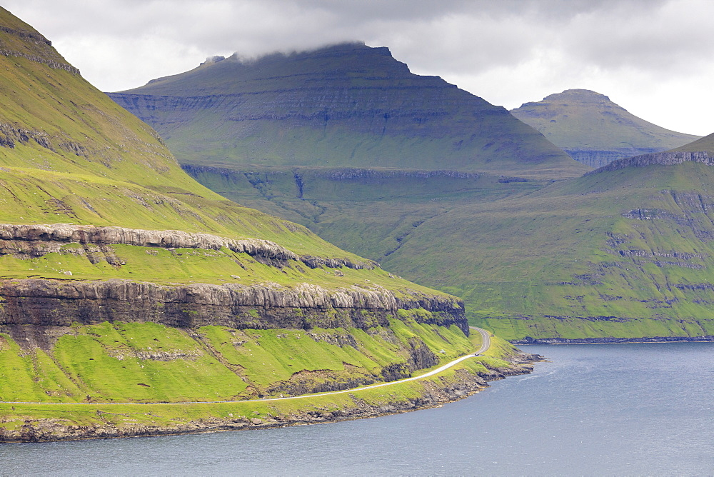 Road along mountain towards Funningur, Eysturoy Island, Faroe Islands, Denmark