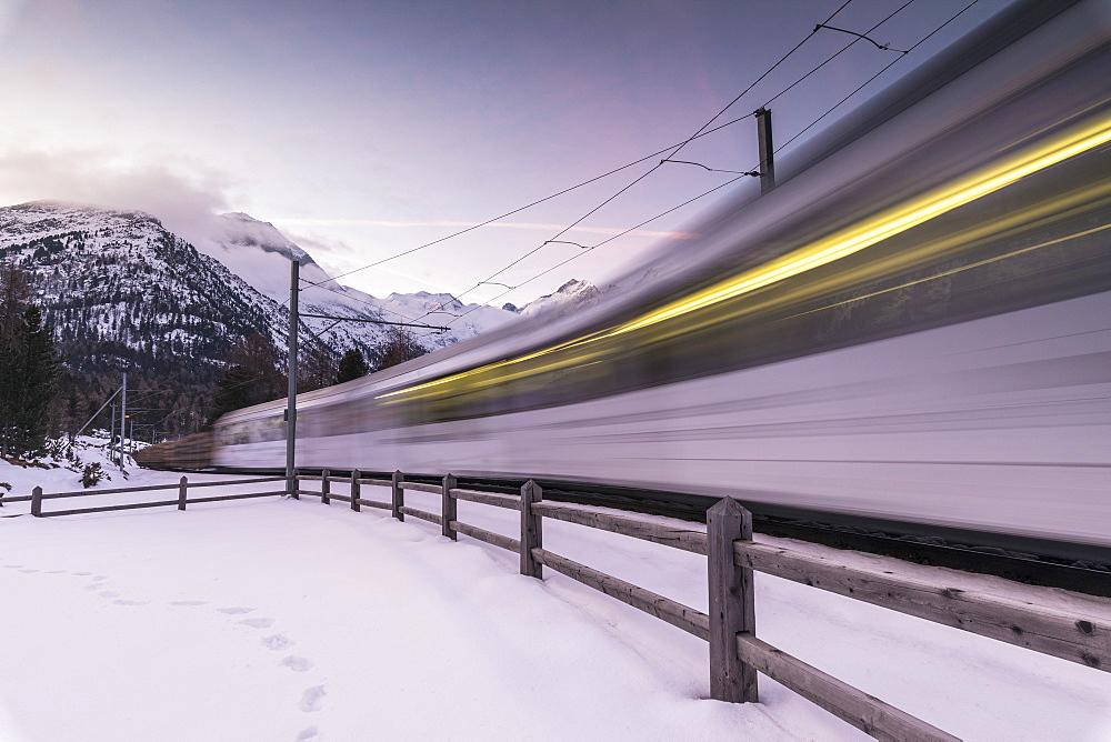 Bernina Express train in the snowy landscape, Morteratsch, Engadine, Canton of Graubünden, Switzerland - 1179-2975