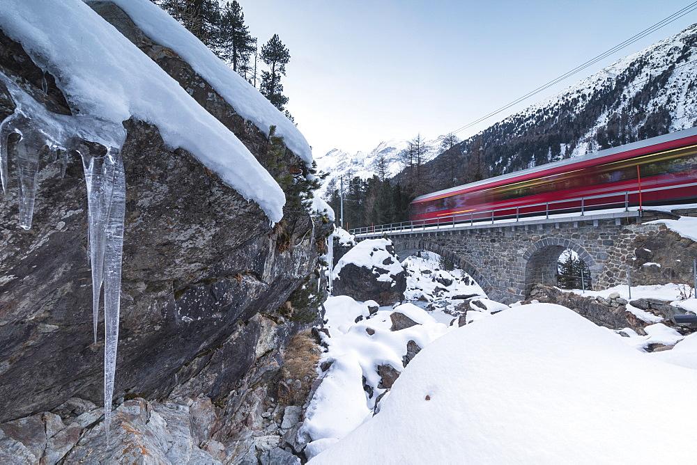 Bernina Express train in the snowy landscape, Morteratsch, Engadine, Canton of Graubünden, Switzerland - 1179-2976
