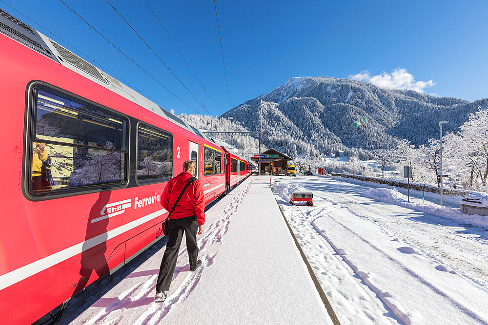 Bernina Express train at Filisur station, Albula Valley, Canton of Graubunden, Switzerland, Europe