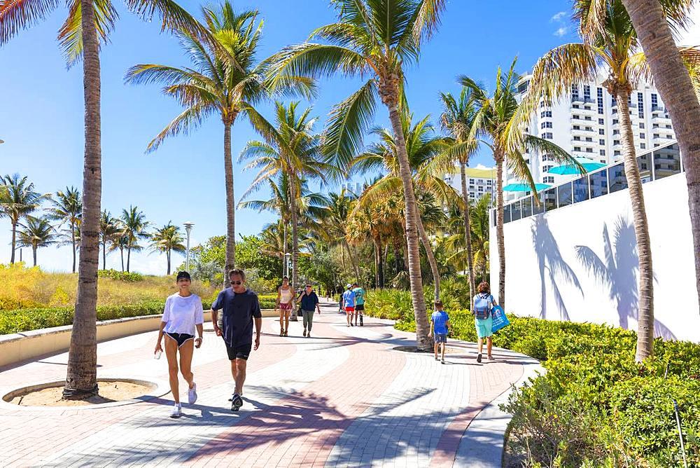 People walk on promenade, Miami Beach, Florida, United States of America, North America