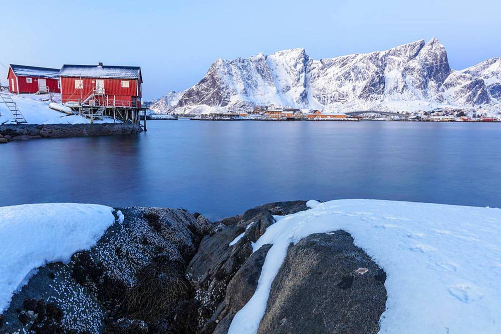 Traditional fisherman's huts (Rorbu) on the icy sea, Reine Bay, Lofoten Islands, Nordland, Norway, Europe