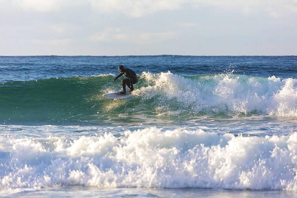Surfer rides waves, Unstad, Vestvagoy, Lofoten Islands, Nordland, Norway, Europe - 1179-3376