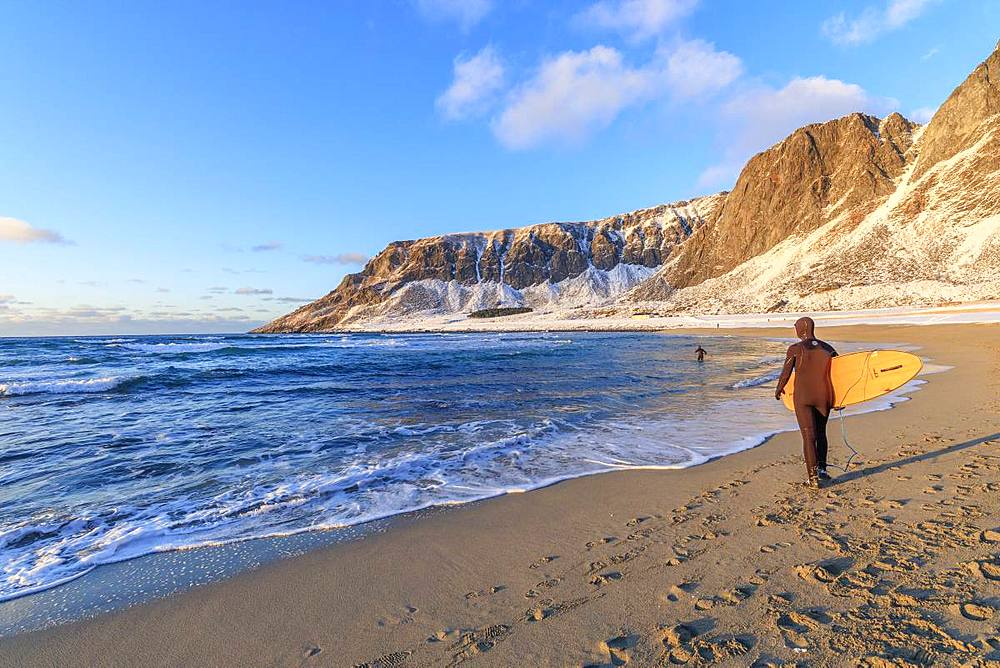 Surfer with surfboard on the beach, Unstad, Vestvagoy, Lofoten Islands, Nordland, Norway, Europe - 1179-3377