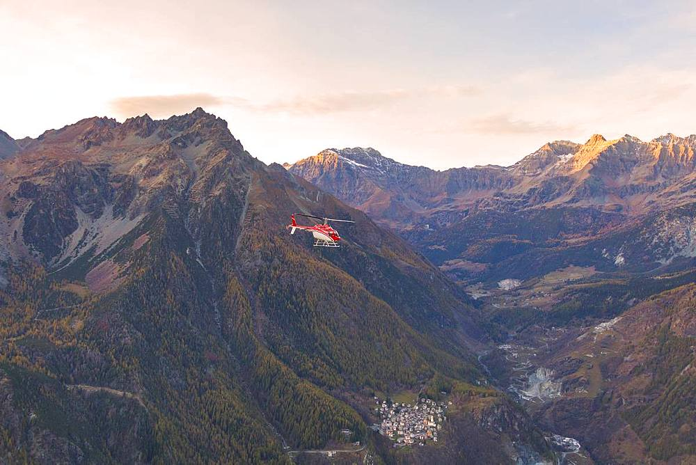 Aerial view of helicopter in flight over Primolo, Valmalenco, Valtellina, Lombardy, province of Sondrio, Italy, Europe