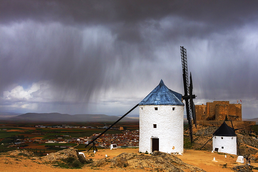 Storm clouds on windmills and castle, Consuegra, Don Quixote route, Toledo province, Castilla-La Mancha (New Castile) region, Spain, Europe