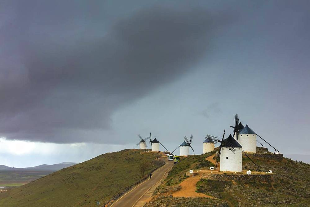 Storm clouds on windmills of Consuegra, Don Quixote route, Toledo province, Castilla-La Mancha (New Castile) region, Spain, Europe