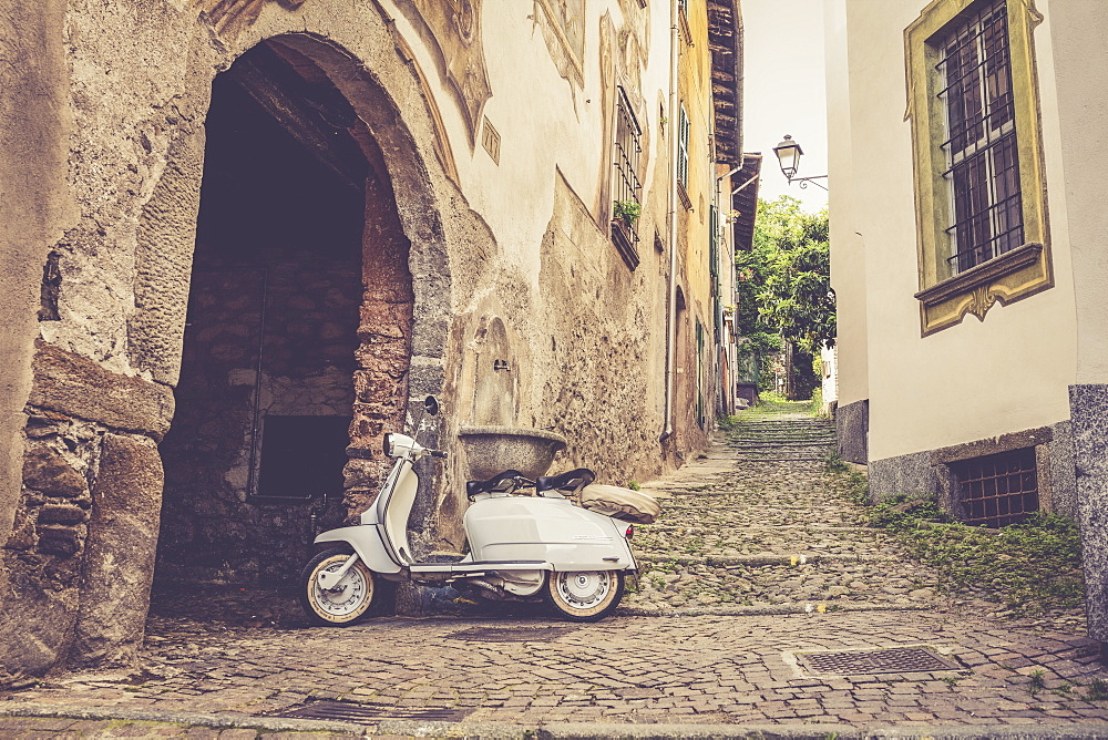 White Lambretta Innocenti scooter in the old alley, Morbegno, province of Sondrio, Valtellina, Lombardy, Italy, Europe
