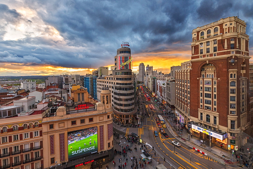 Elevated view of Plaza del Callao (Callao Square), Capitol Building and Gran Via at sunset, Madrid, Spain