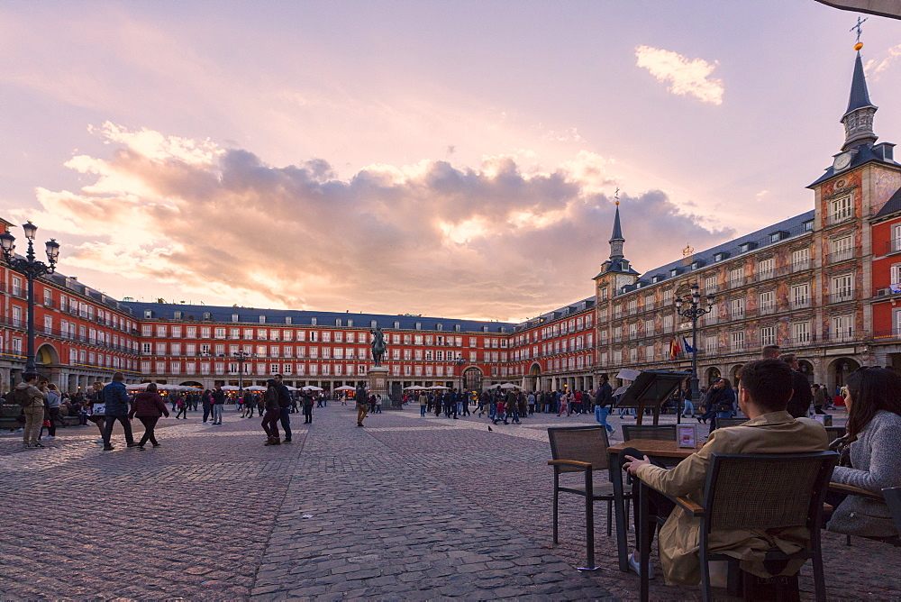 People in Plaza Mayor at sunset, Madrid, Spain