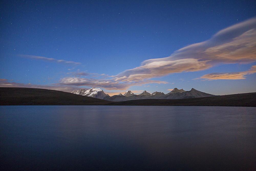 View of Gran Paradiso range at sunset from Lake Rossett (Lago Rossett), Colle del Nivolet, Alpi Graie (Graian Alps), Italy, Europe