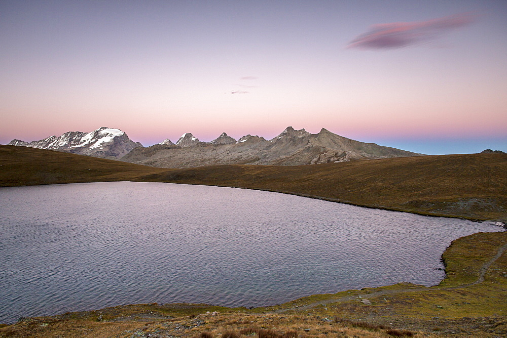Sunset on Rosset Lake at an altitude of 2709 meters, Gran Paradiso National Park, Alpi Graie (Graian Alps), Italy, Europe