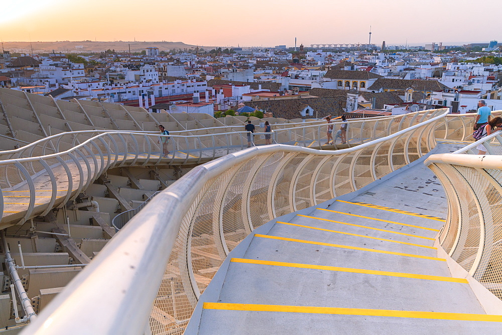 People on curved walkways admire the city skyline, Metropol Parasol, Plaza de la Encarnacion, Seville, Andalusia, Spain, Europe