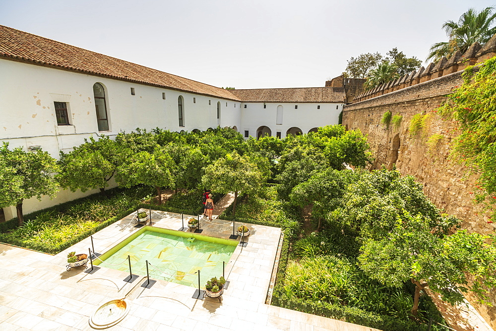 Tourists in the courtyard surrounded by defensive wall of fortress, Alcazar de los Reyes Cristianos, Cordoba, UNESCO World Heritage Site, Andalusia, Spain, Europe - 1179-3724
