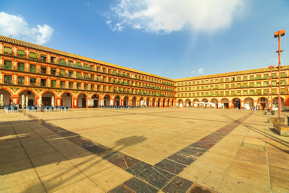 Orange colored buildings and arcades of Plaza de la Corredera (Corredera Square), the main square of Cordoba, Andalusia, Spain, Europe