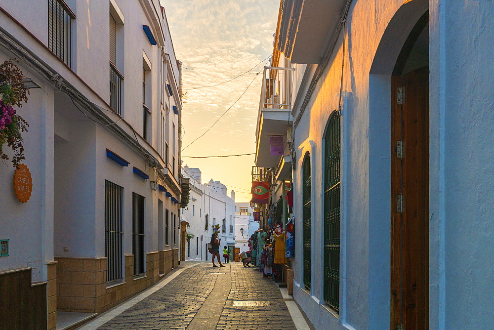 People in the medieval alley of the city center, Conil de la Frontera, Costa de la Luz, Cadiz Province, Andalusia, Spain