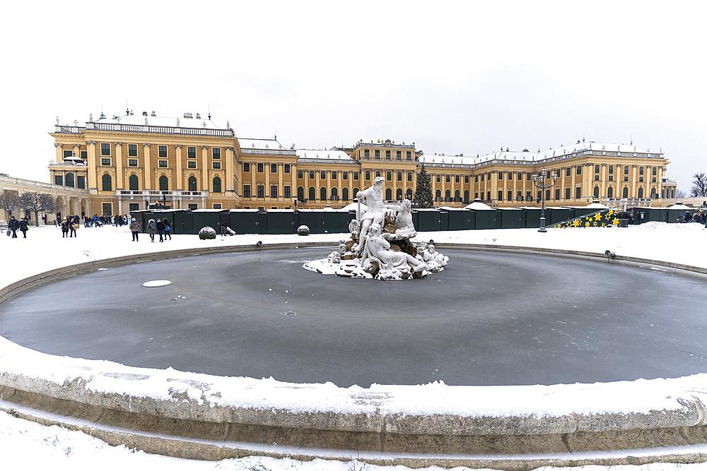 Frozen water of Naiad Fountain and snow around Schonbrunn Palace, UNESCO World Heritage Site, Vienna, Austria, Europe