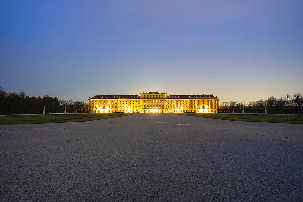 Illuminated facade of Schonbrunn Palace and Castle at dusk, UNESCO World Heritage Site, Vienna, Austria, Europe