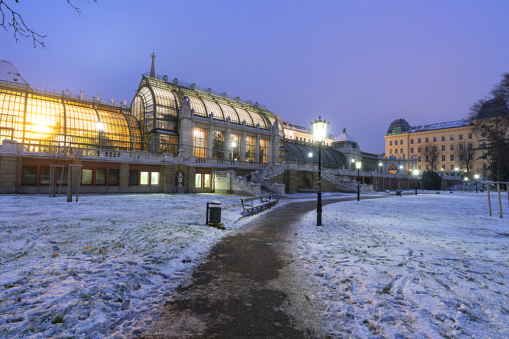 Palmenhaus greenhouse view from the Hofburg palace gardens covered with snow, Burggarten, Vienna, Austria, Europe