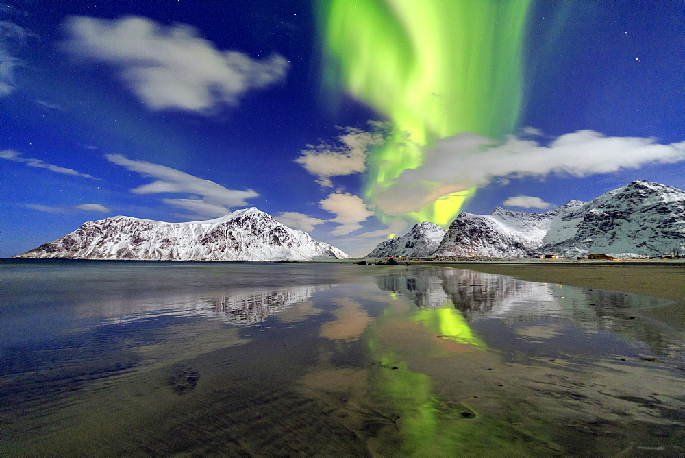 Northern Lights (aurora borealis) and mountains reflected in the cold waters, Skagsanden, Lofoten Islands, Arctic, Norway, Scandinavia, Europe