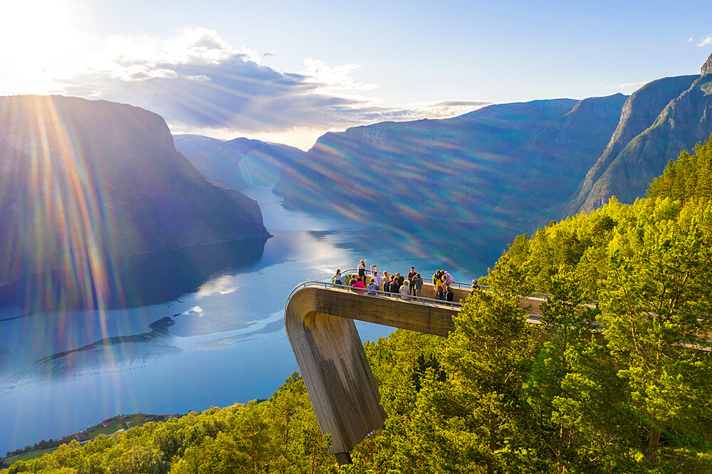 Tourists admiring the fjord from Stegastein viewpoint, Aurlandsvangen, Sognefjord, Norway (drone)