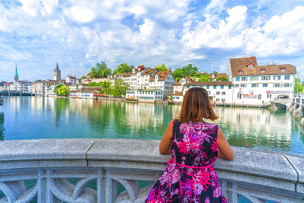 Rear view of woman leaning on terrace over Limmat River admiring the old buildings of Lindenhof, Zurich, Switzerland, Europe - 1179-4027