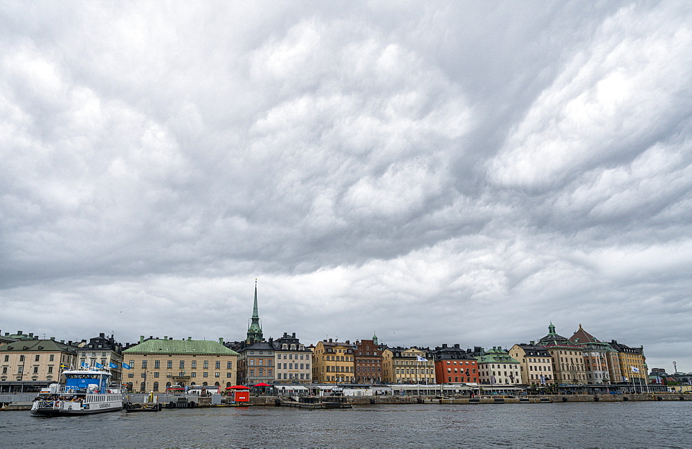 Storm clouds over the historic buildings of Gamla Stan by the sea, Stockholm, Sweden, Scandinavia, Europe