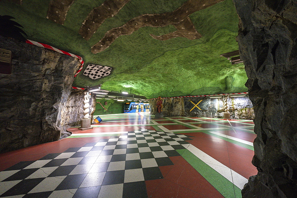 Kungstradgarden Metro station, hewn into the bedrock and painted with vibrant colors to represent the ecosystem, Stockholm, Sweden, Scandinavia, Europe