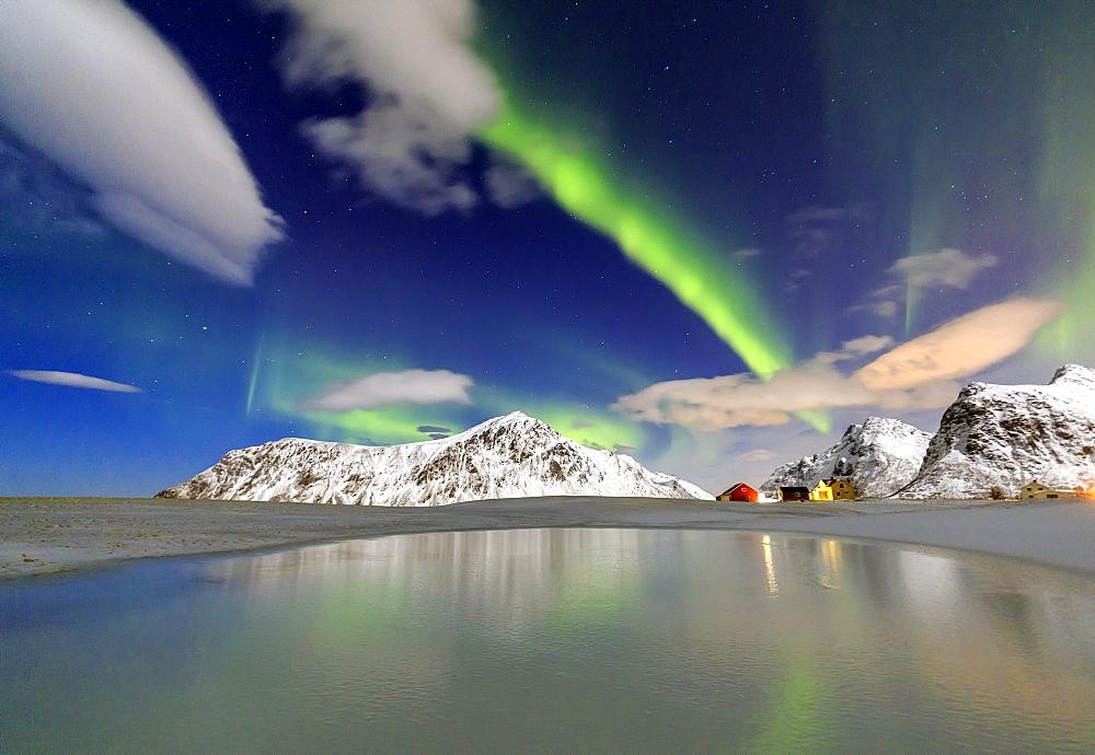 Northern Lights (aurora borealis) reflected in the cold waters, Flakstad, Lofoten Islands, Arctic, Norway, Scandinavia, Europe
