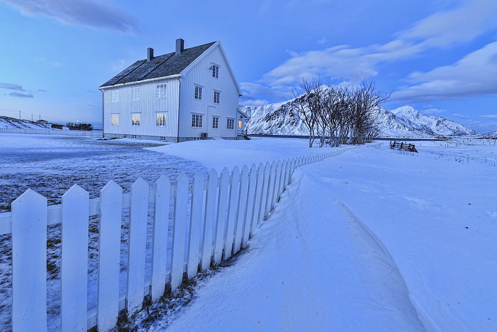 Typical house surrounded by snow at dusk, Flakstad, Lofoten Islands, Norway, Scandinavia, Europe