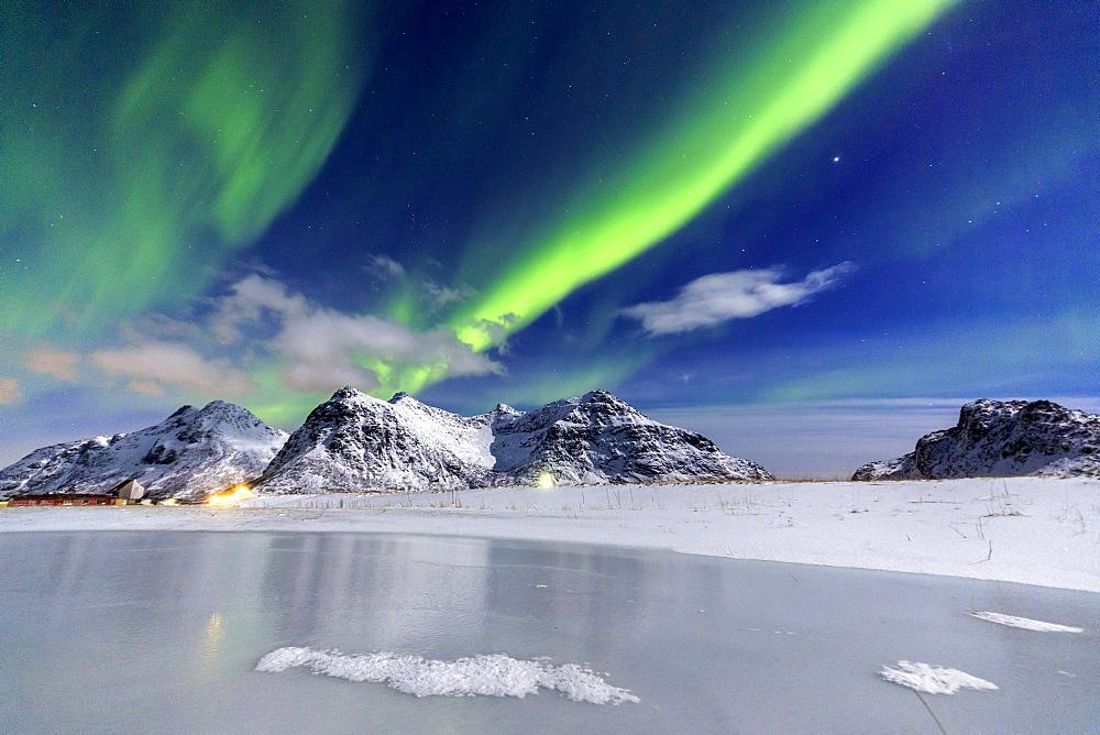 Northern Lights (aurora borealis) illuminate the sky and the snowy peaks, Flakstad, Lofoten Islands, Arctic, Norway, Scandinavia, Europe - 1179-449