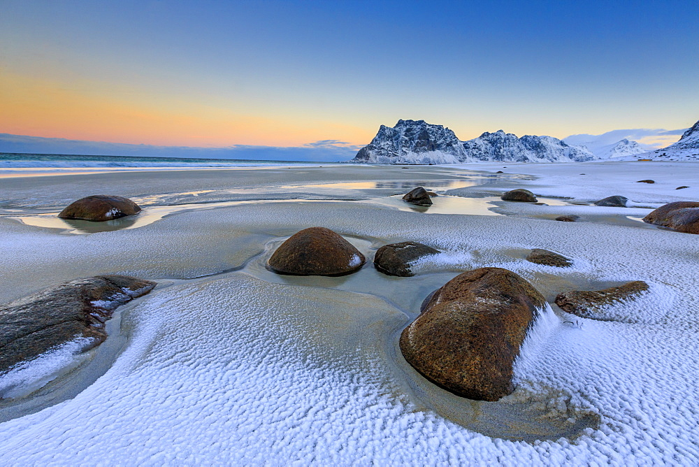 Dawn illuminates the rocks shaped by wind surrounded by fresh snow, Uttakleiv, Lofoten Islands, Arctic, Norway, Scandinavia, Europe - 1179-458