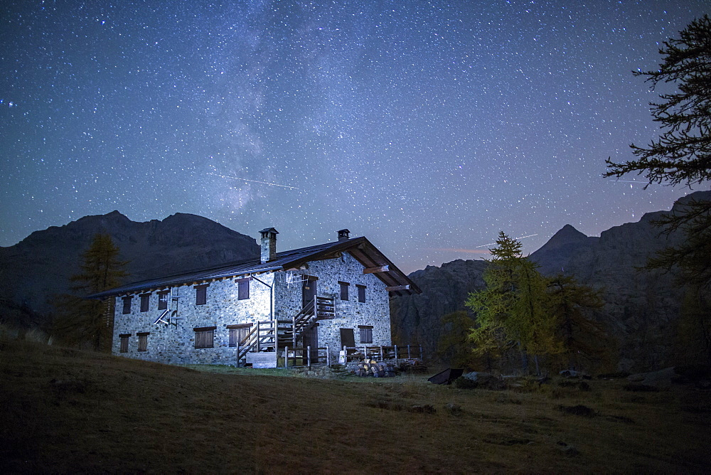Starry night on Barbustel Refuge, Natural Park of Mont Avic, Aosta Valley, Graian Alps, Italy, Europe